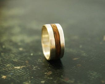 Mens wedding band in silver and wooden ring.