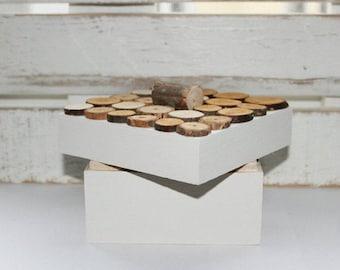 Wooden box, wooden casket. White, tree trunks