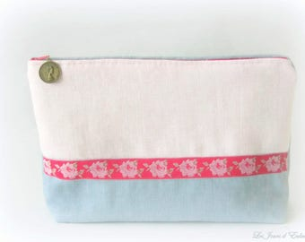 Toiletry bag in linen pink and blue.