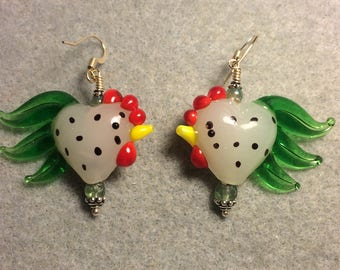 Milky white and green heart shaped lampwork rooster bead earrings adorned with green Czech glass beads.