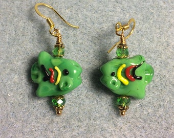 Opaque green lampwork fish bead earrings adorned with green Chinese crystal beads.