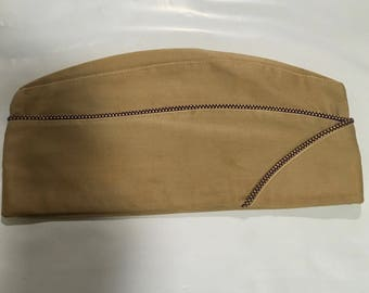 A military cap. Either Intelligence or Chem Warfare