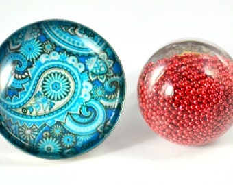 X 2 rings 1 ring cubic globe filled of micro red ball + 1 pattern blue cabochon ring