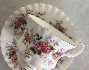 Royal Albert lavender rose pattern tea cup and saucer with small pink roses and purple leaves