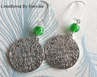 Earrings with round Celtic stamp and a crackled green bead