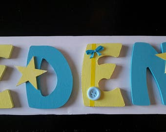 Wooden name letter on blue theme