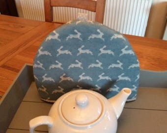 Tea cosy, Tea cozy in a duck egg blue fabric with leaping hares.