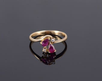 10k 0.42 Ctw Ruby* Diamond Pear Accent Bypass Ring Gold