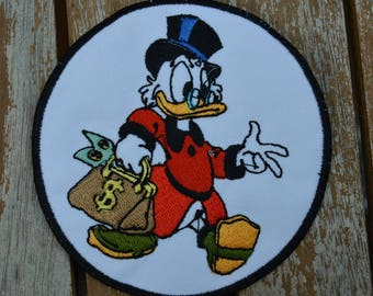 Scrooge embroidered badge