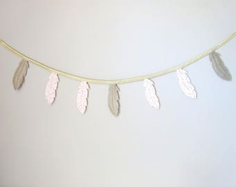 Garland of feathers in nude (light pink) and gold lame linen fabric