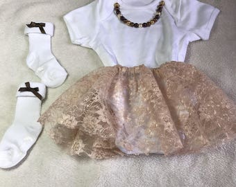 Baby vest with lace skirt