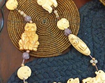 Cat Around carved Buffalo bone cat necklace