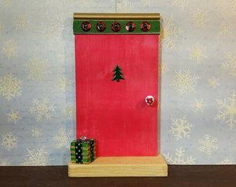 Red Elf Door with Metallic Tree and Christmas Present