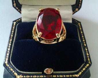 gold coloured 925 red stone dress ring