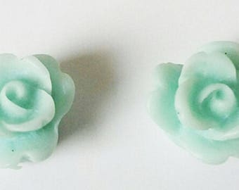 2 small flowers - light blue resin cabochons