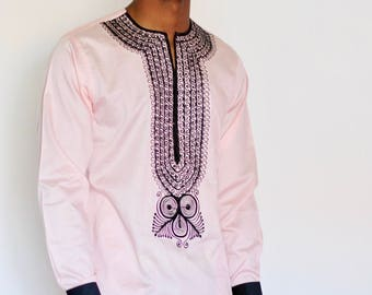 Off pink embroidered top by Christian Alaro