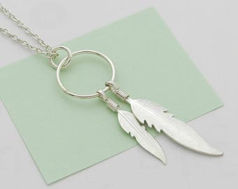 2 silver feathers