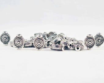 INT60 - 10 beads spacers Vintage round shaped spiral patterns on both sides in antique silver