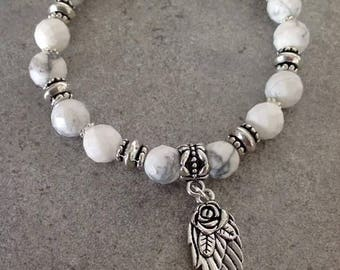 Please Bracelet energized, well being, white howlite faceted with its floral angel wing