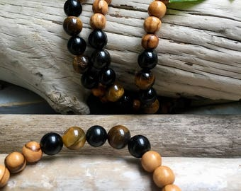 Wood of olive wood from Bethlehem, obsidienn and Tiger eye bracelet