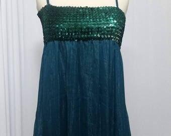 Green dress with rhinestones on top