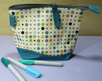 Zipped pouch in multi colour polka dot fabric, medium size.