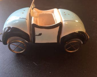 1930's-1940's salt and pepper shaker and holder that looks like a car (volkswagon maybe).