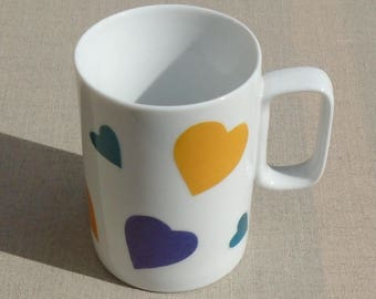 Porcelain decorated with purple, turquoise and yellow hearts mug