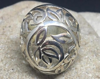Sterling Silver Statement Ring featuring delicate flowers surround by leaves. Dome style work