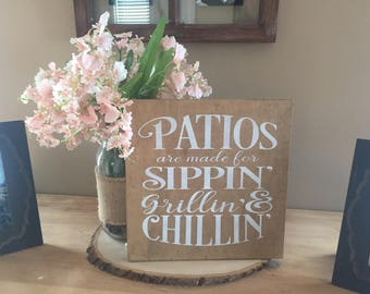 PATIOS are made for sippin' chillin' and grillin', outdoor wood sign
