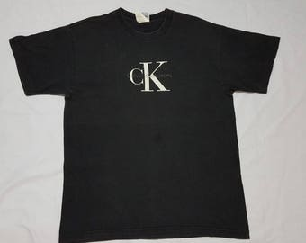 Vintage CK CALVIN KLEIN Jeans Spellout Big Logo Black T Shirt Made In Usa