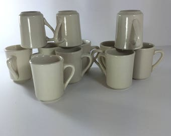 "Ultima restaurant ware mugs , off white, 4""tall-3""diameter --11 pieces"