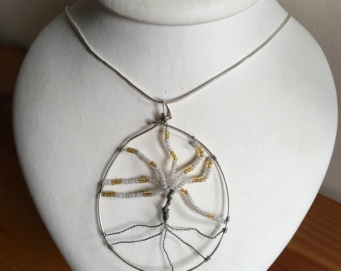 Tree of life pendant with white and gold beads