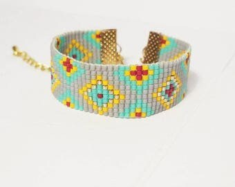 Grey, red, turquoise woven bracelet