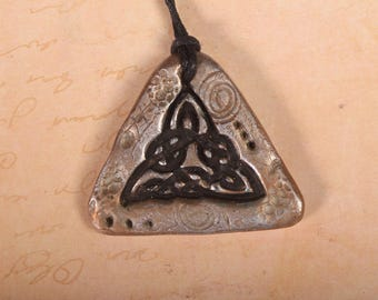 Rustic / primitive trianglular clay celtic trinity  knot pendant