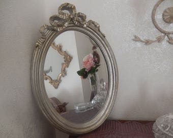 oval mirror romantic antique old silver with a bow