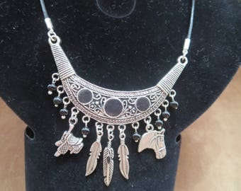 country leather saddle and horse head necklace