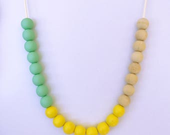 Pastel yellow, tiffany green and raw wooden bead necklace