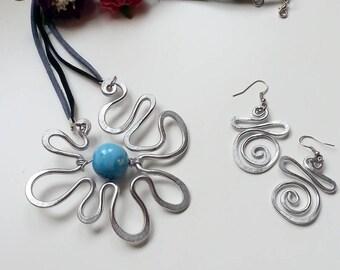 Most Sun pendant earrings