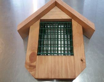 Hand crafted wooden suet feeder.