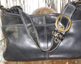 This is a vintage Genuine Leather Coach Black Coach Shoulder Bag. Truly Vintage