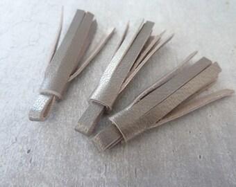 3 pompons 5 cm franges cuir bronze irisé