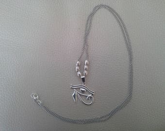 silver chain and eye of Horus pendant