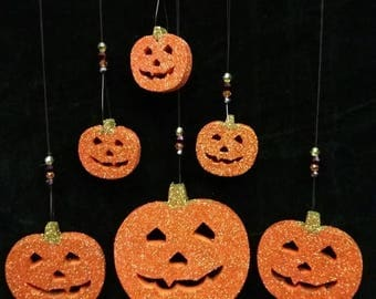 Halloween glittered pumpkin decorations with bicone beads