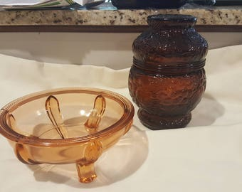 "Set of 2 Vintage Candy Dishes - One Dark Amber Pressed Glass ""Turnabout"" Canister Jar with Lid and One Light Amber Glass Footed Candy Dish"
