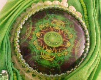 Silk Shibori - Cuff Bracelet green with pale yellow decorative elements.