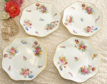 Set of four Coalport hand painted side plates