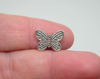18 Silver Tone Butterfly Beads. B-026
