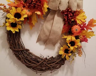Fall grapevine wreath with flowers and ribbon