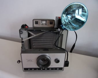 Vintage Polaroid with Flashgun